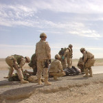 Canadian troops evacuate wounded soldiers after their vehicle was hit by an oncoming vehicle near Kandahar City. Photo: Corporal Robin Mugridge