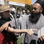 Voor- en tegenstanders van het gebruik van shari'a tijdens een demonstratie in Toronto (foto CP).