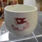 Kopje met het logo van de White Star Line.