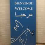 Welkomstwoord aan Syrische vluchtelingen op het vliegveld van Montreal